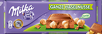 Шоколад молочный Milka Ganze Haselnusse (милка с цельным фундуком), 300 г.Германия