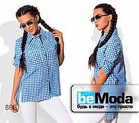 Молодежная женская рубашка в клетку оригинального кроя синяя