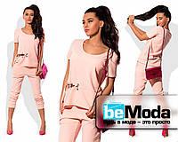Модный женский костюм из кофты с декоративной шнуровкой и облегающие брюки розовый