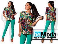Яркий женский комплект из блузы и узких брюк бирюзовый