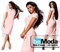 Привлекательное женское платье облегающего кроя средней длины розовое