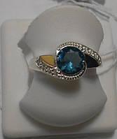 Серебряное кольцо с золотом и голубым кристалом Взгляд