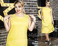 Яркое летнее платье свободного кроя в желтом цвете. Платье без рукавов, с небольшим, полукруглым вырезом.