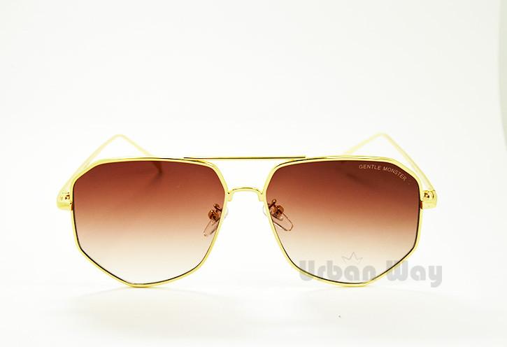 Солнцезащитные очки с золотой оправой