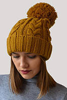 Классическая вязанная косами шапочка