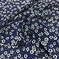 Шифон-органза з маленькими білими квіточками на темно-синьому тлі