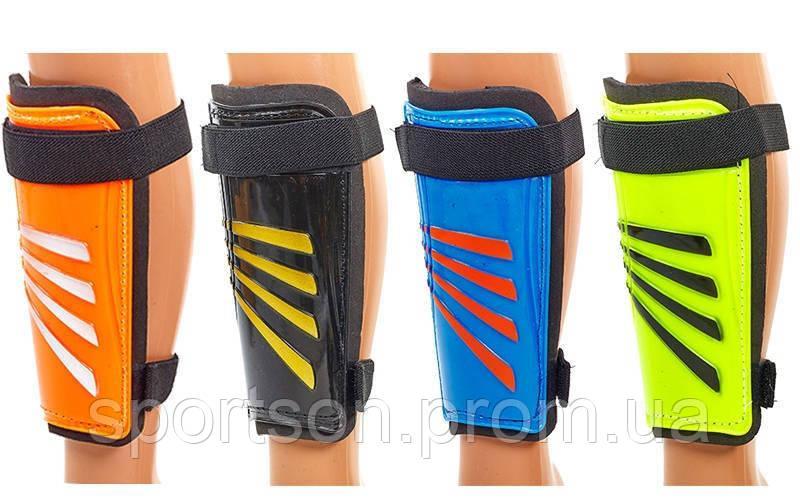 Щитки футбольные FB-618 (пластик, EVA, l-18см, р-р М, синий, оранжевый, черный, салатовый)