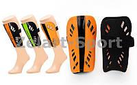 Щитки футбольные LOTTO FB-661-M (пластик, EVA, l-18,5см, р-р M, черный, салат., оранжевый)