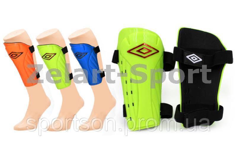 Щитки футбольные UMB FB-6255-M (пластик, EVA, l-19,5см, р-р M, синий, салат., оранжевый)