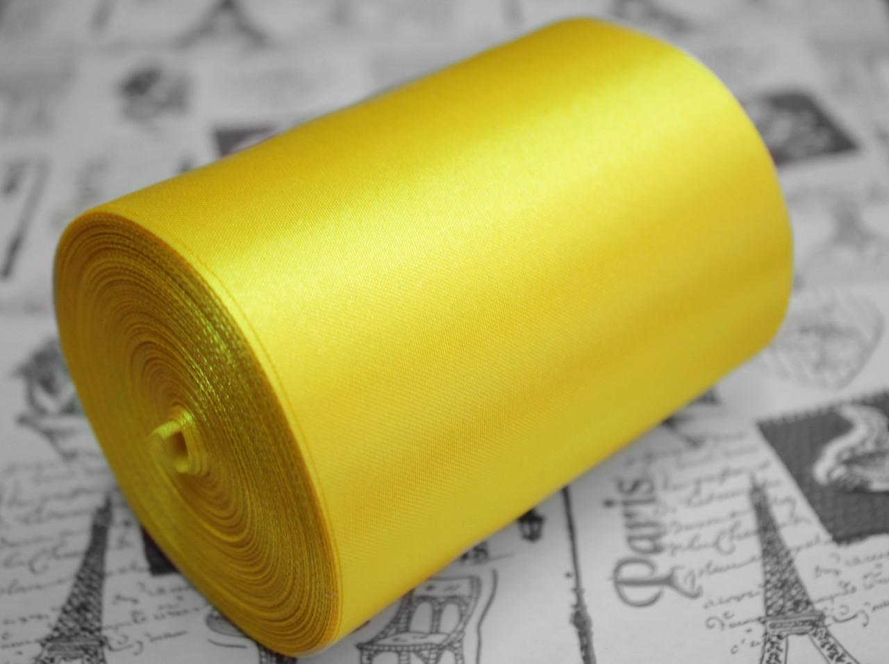 Лента атласная ярко- желтая (ширина 10см, намотка 20м)
