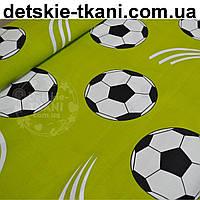 Ткань хлопковая с мячами на зелёном фоне (№ 750а)