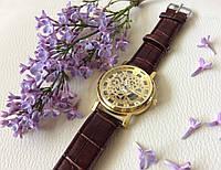 Наручные часы с оригинальным дизайном. Коричневые