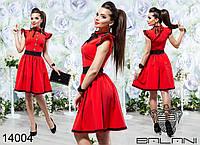 Элегантное платье приталенного силуэта с пышной юбкой,декорировано цветными вставками и пуговицами.