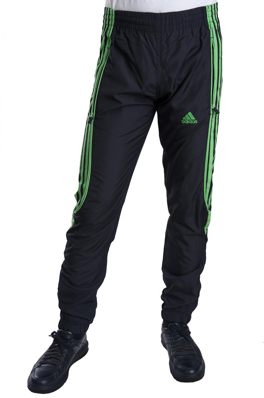 Мужские спортивные штаны Adidas черного цвета c зелеными полосками (плащевка). Хмельницкий