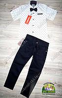 Нарядный костюм для мальчика: белая рубашка с коротким рукавом и черные брюки