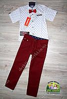 Нарядный костюм для мальчика: белая рубашка с коротким рукавом и бардовые брюки