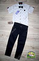 Костюм нарядный для мальчика: белая рубашка с коротким рукавом и черные брюки