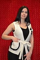Тёплая женская безрукавка с карманами