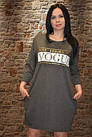 Женская тёплая туника с карманами