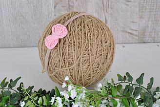 Пов'язка з плетеним рожевим бантиком