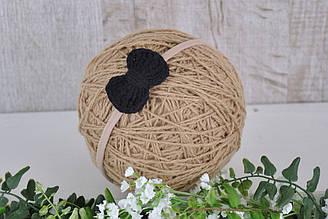 Пов'язка з плетеним чорним бантиком