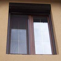 Ламинированное металлопластиковое окно Rehau Euro 70 со шпроссами.