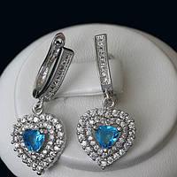 R5-0134 - Серьги с ярко-голубыми и прозрачными фианитами родий