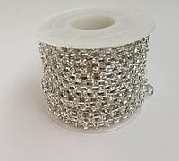 Стразы прозрачные в цапах на металической ленте под серебро, 50 см