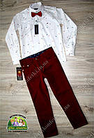 Нарядный костюм для мальчика на выпускной: белая рубашка и бордовые брюки
