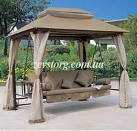 Садовая качель-диван с москитной сеткой.