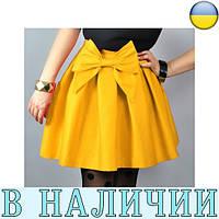 Симпатичная расклешенная юбка с бантом False