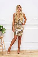 Женское платье с золотыми паетками