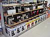 Стеллаж торговый под бытовую технику. Стеллажи для магазина электроники. Торговое оборудование WIKO