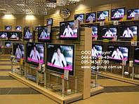 Стеллажи торговые для телевизоров. Стеллаж для магазина электроники. Торговое оборудование WIKO для магазина