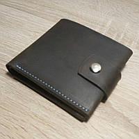 Кожаное портмоне коричневое на кнопке