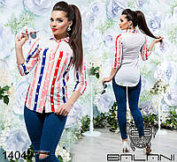 Женская стильная рубашка асимметричной длины в полоску.