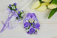 Декорированные свадебные свечи и украшение на шампанское