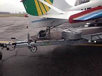 Прицеп для самолёта. Прицеп для перевозки небольшого самолёта.