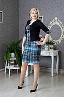 Нарядное трикотажное платье с геометрическим узором, зрительно имитирует костюм