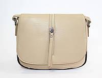 Маленькая женская сумочка бежевого цвета
