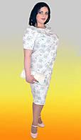 Наряднный женский костюм: платье и жилетка с цветочным принтом