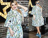 Нежное платье свободного кроя шикарно смотрится на фигуре. Модель с цветочным принтом.