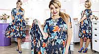Потрясающее платье, имеет небольшой полукруглый вырез, короткий рукав, и развевающуюся юбку миди длинны.