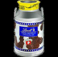Швейцарский шоколад Lindt swiss premium  в молочнике с мелодией 325g