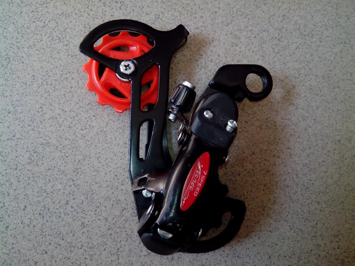 Переключатель задний простой к горному велосипеду