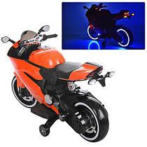 Дитячий електричний мотоцикл M 3467 EL-7 помаранчевий, шкіряне сидіння і м'які колеса
