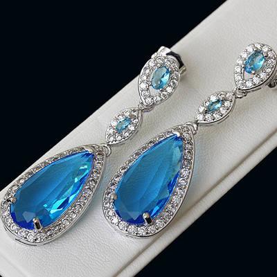 009-0158 - Серьги с ярко-голубыми и прозрачными фианитами родий