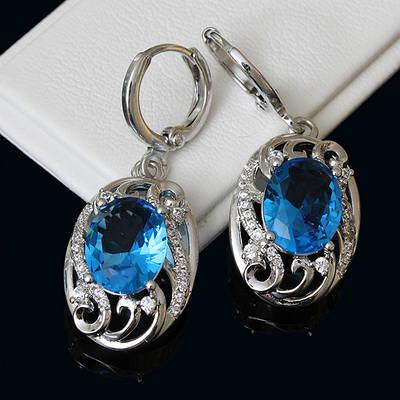 009-0163 - Серьги с ярко-голубыми и прозрачными фианитами родий