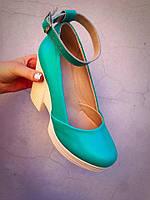 Туфли модель Rita женские из натуральной кожи. Танкетка спереди 2,5 см, сзади 10,5 см. Размерный ряд: 36-40.