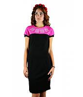 Черное двухцветное платье с яркой геометрической вышивкой